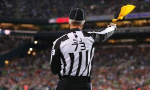 empire-sports-NFL-referee-throwing-flag-no-touch-quarterback-qb